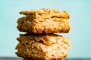 Flaky biscuits stacked up high.