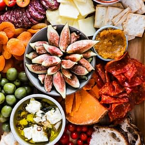 Honeyed figs, cheese, crackers and dips for you to build a better cheeseboard.