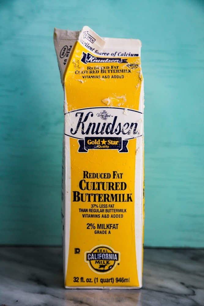 A yellow carton of buttermilk, covered in flour.